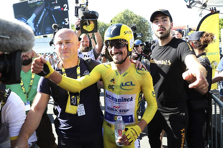 France's Julian Alaphilippe wearing the overall leader's yellow jersey celebrates after winning the 13th stage of the Tour de France, an individual time trial over 27.2 kilometers (16.9 miles) with start and finish in Pau, France, Friday, July 19, 2019. (Thibault Camus/AP)