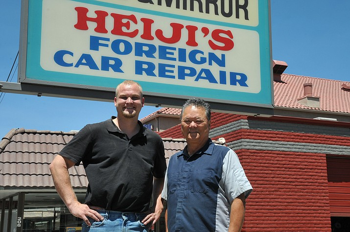 Heiji Klotzbach, right, and Wesley Goodwin stand outside of Heiji's Foreign Car Repair. (Doug Cook/Courier)