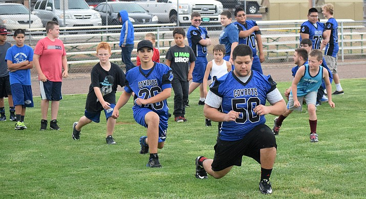 Camp Verde High School players and campers warm up at the Cowboys' youth football camp in 2016. CVHS and Camp Verde Youth Football & Cheer will put on the camp this Tuesday through Thursday. VVN file photo
