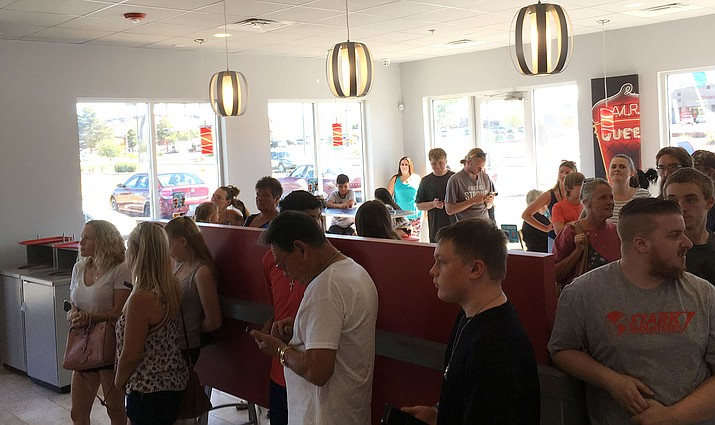 Customers line up inside Dairy Queen during its soft opening Saturday, July 20. (Photo by Beau Bearden/Daily Miner)