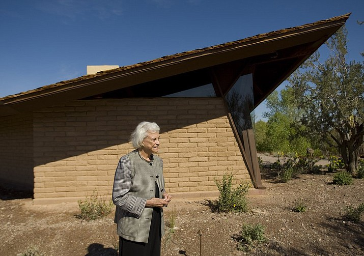 In this 2010 photo, retired Supreme Court Justice Sandra Day O'Connor stands in front of her 1958 adobe home. The State Historic Preservation Office's announcement Friday, July 19, 2019, says the National Park Service approved Arizona's nomination of the Sandra Day O'Connor House for placement on the National Register of Historic Places. (David Wallace/The Arizona Republic)