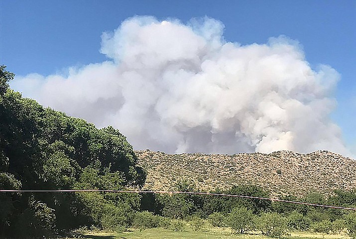 Cloudy skies and higher humidity on Friday combined to help firefighters improve containment of the Cellar Fire south of Prescott. Courtesy of The Daily Courier