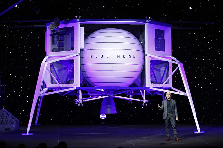 In this, May 9, 2019, file photo, Jeff Bezos speaks in front of a model of Blue Origin's Blue Moon lunar lander in Washington. Bezos and Virgin Galactic's Richard Branson favor going back to the moon before Mars. SpaceX's Elon Musk also is rooting for the moon, although his heart's on Mars. (Patrick Semansky/AP, File)