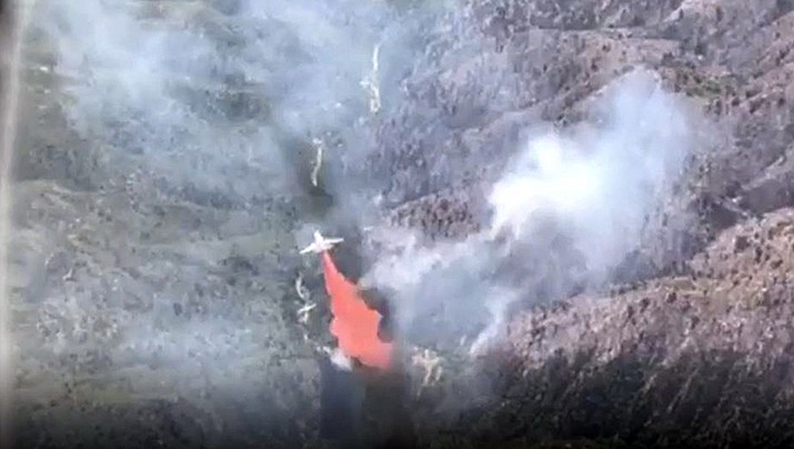 A slurry bomber hits the Cellar Fire south of Prescott on Saturday, July 20, 2019. (Courtesy, USDA from video)