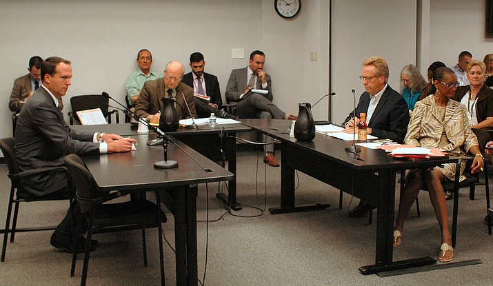 State utility regulators debate limits June 20, 2019 on the ability of electric companies to shut off power to customers during the summer because of unpaid bills. From left are Justin Olson, Bob Burns, Boyd Dunn and Sandra Kennedy. (Capitol Media Services photo by Howard Fischer)