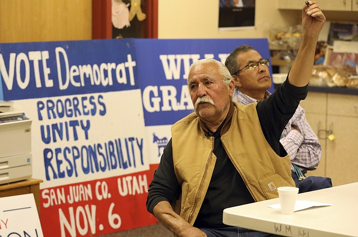 In this Oct. 24, 2018, file photo, Democratic county commission candidate Willie Grayeyes, left, speaks to a group while Kenneth Maryboy, a Navajo who is running unopposed for another seat on the commission, looks on in White Mesa, Utah. A federal appeals court on Tuesday, July 16, 2019, upheld newly drawn voting districts in a Utah county after a judge had found the old boundaries amounted to racial gerrymandering and violated the rights of Navajo voters. Since then, a Navajo Democrat, Grayeyes fought in court to get on the ballot and later won a county commissioner seat. (AP Photo/Rick Bowmer, File)
