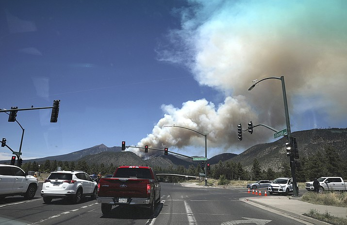 The Museum fire burns Sunday, July 21, 2019, as seen from the top of Switzer Mesa in Flagstaff, Ariz. (Jake Bacon/Arizona Daily Sun via AP)