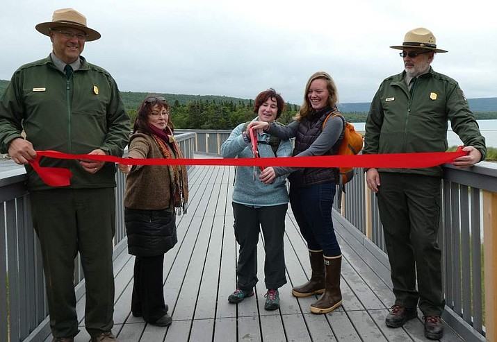 Katmai Superintendent Mark Sturm, Katmai Conservancy representative Shiela Ring, Lucy Murfitt and Annie Hoefler (representing Senator Lisa Murkowski), and NPS Alaska Regional Director Herbert Frost cut a ribbon on Katmai's new Brooks River Bridge July 16. (Photo/NPS)