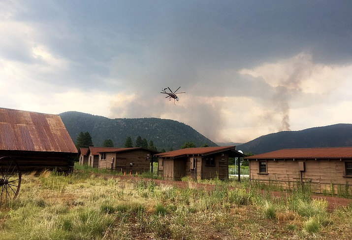 Helicopters transport water to the Museum Fire from a location near Highway 180. Gov. Doug Ducey declared a state of emergency earlier today, ensuring first responders have the resources needed to fight the fire. (Katherine Locke/NHO)