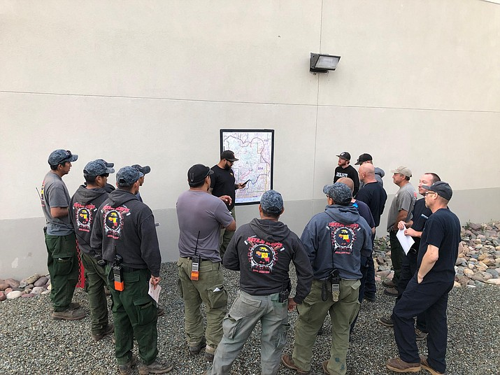 Firefighters meet a morning briefing about the Cellar Fire Tuesday, July 23, to discuss their assignment for the day. (USFS/Courtesy)