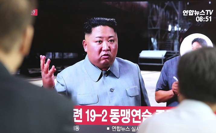 People watch a TV showing a file image of North Korean leader Kim Jong Un during a news program at the Seoul Railway Station in Seoul, South Korea, Thursday, July 25, 2019. North Korea fired two unidentified projectiles into the sea on Thursday, South Korea's military said, the first launches in more than two months as North Korean and U.S. officials struggle to restart nuclear diplomacy. (AP Photo/Ahn Young-joon)