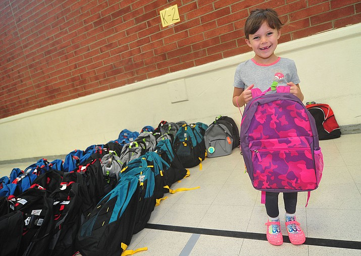 Peyton Rutter and other Prescott Unified School District families pick up backpacks stuffed with school supplies for each of their PUSD students on Wednesday July 24, 2019.  (Les Stukenberg/Courier)