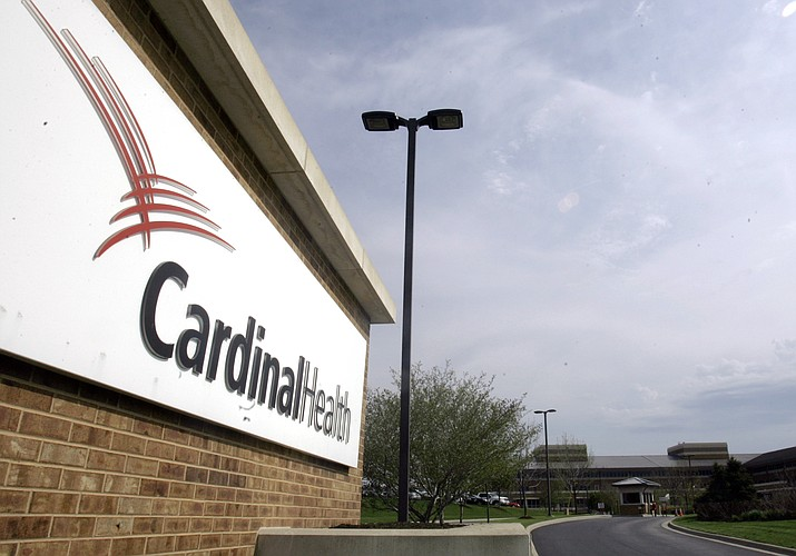 FILE - This April 30, 2007, file photo, shows the headquarters of Cardinal Health in Dublin, Ohio. An executive at Cardinal Health, one of the nation's largest drug distribution companies, said in a legal proceeding that the business has no obligation to the public when it comes to shipping prescription opioid painkillers. That's one of the disclosures in thousands of pages of court documents made public July 23, 2019, in lawsuits over the opioid crisis. (AP Photo/Kiichiro Sato, File)