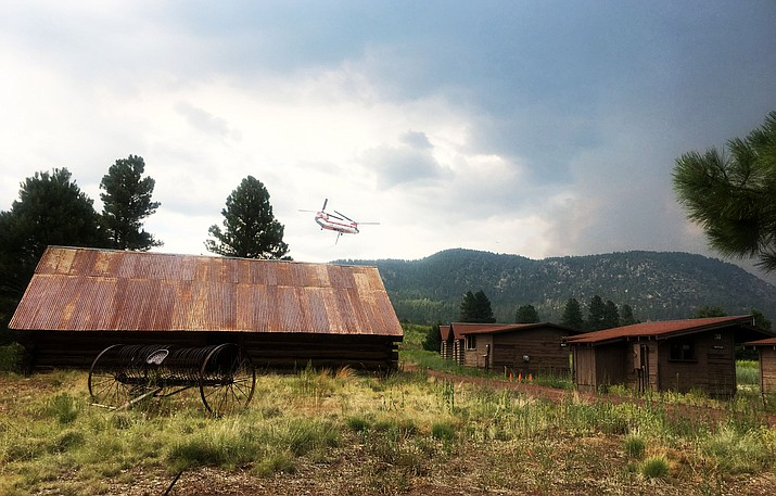 A helicopter departs the Museum of Northern Arizona to sling-load a bucket of water on the Museum Fire July 23. (Katy Locke/NHO)