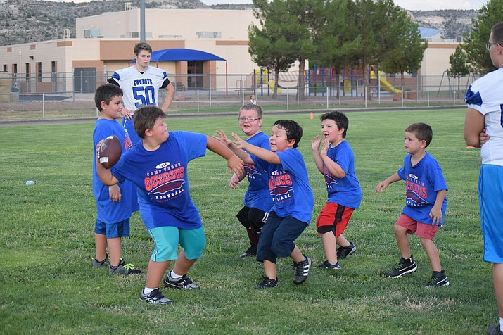 Campers play a touch football game on Wednesday night at the Camp Verde Football Camp. VVN/James Kelley