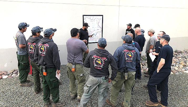 Firefighters meet for a morning briefing about the Cellar Fire to discuss their assignment for the day. (USFS/Courtesy)