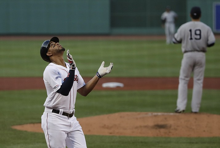 Boston Red Sox's Xander Bogaerts celebrates his three-run homer against New York Yankees starting pitcher Masahiro Tanaka (19) in the first inning of a game at Fenway Park, Thursday, July 25, 2019, in Boston. (Elise Amendola/AP)