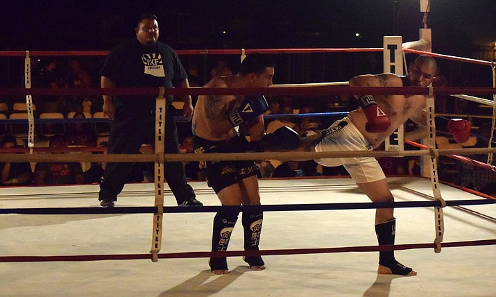 Victor Romero, of Camp Verde, (white trunks) won the main event at the Sweet Corn: IKF Kickboxing Championship at Cornfest. VVN/James Kelley
