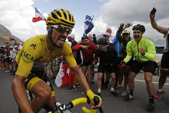 France's Julian Alaphilippe wearing the overall leader's yellow jersey climbs the Galibier pass during the 18th stage of the Tour de France over 208 kilometers (130 miles) with start in Embrun and finish in Valloire, France, Thursday, July 25, 2019. (Christophe Ena/AP)