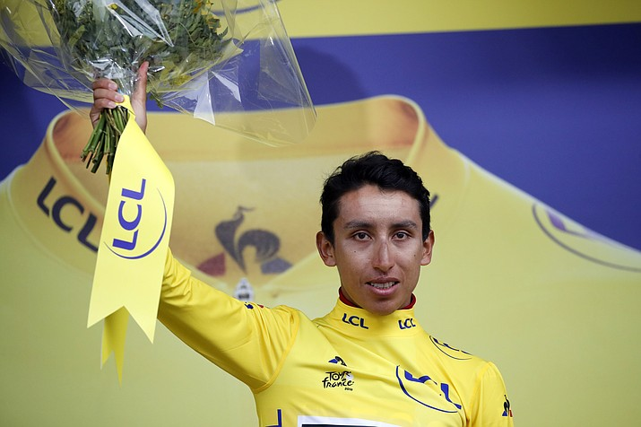 New overall leader Colombia's Egan Arley Bernal Gomez wearing the yellow jersey celebrates on the podium after the 19th stage of the Tour de France with start in Saint Jean De Maurienne, France, Friday, July 26, 2019. (Christophe Ena/AP)