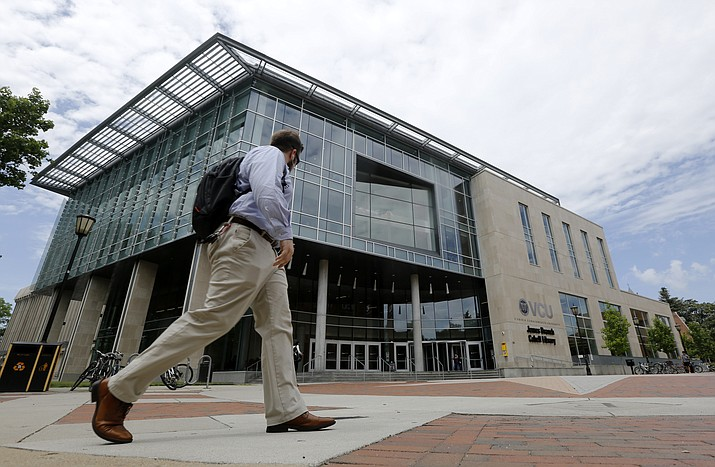 "A Virginia Commonwealth University student walks past the library June 20, 2019, at the school in Richmond, Va. Some debts that bring the promise of opportunity, like student loans or mortgages, might seem ""good,"" but that's not always the case. And having credit card debt isn't always bad. What makes debt ""good"" or ""bad"" depends on how it fits into your overall financial picture. (Steve Helber/AP)"