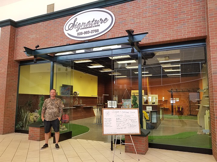 Gary Lambertson stands in front of his new business, Signature Landscaping and More, at the Prescott Gateway Mall. (Max Efrein/Courier)