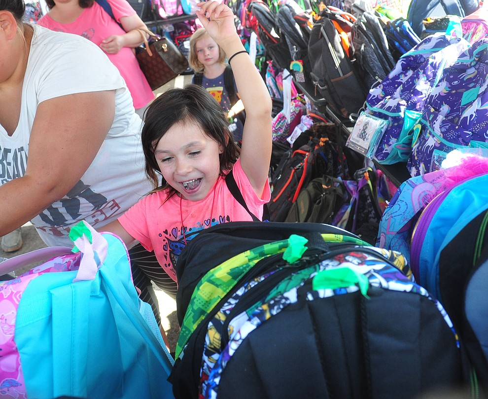 Chino Valley's Elena Canuel scores a backpack as the Yavapai Food Bank gave away 1300 backpacks in the parking lot of Findlay Toyota Center Saturday July 27, 2019 in Prescott Valley. (Les Stukenberg/Courier)