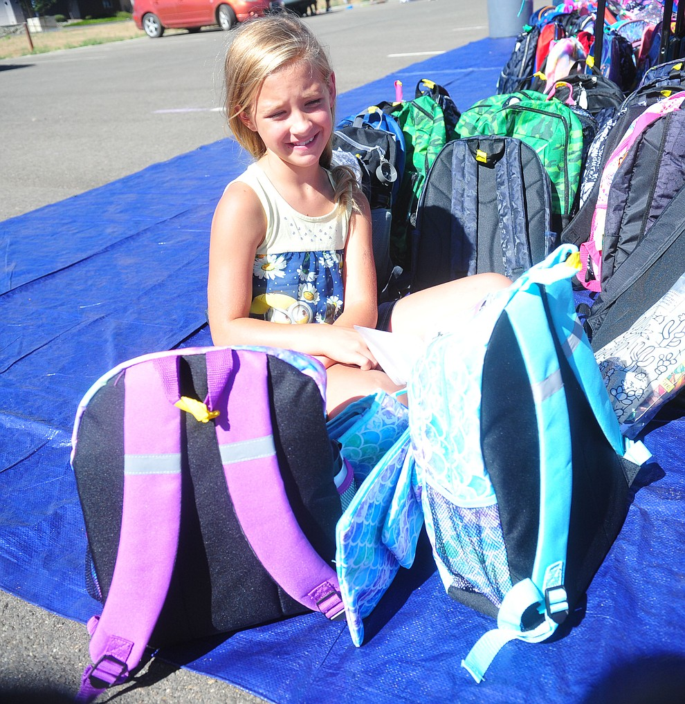Chino Valley's Allanah Call has to make a decision between two backpacks as the Yavapai Food Bank gave away 1300 backpacks in the parking lot of Findlay Toyota Center Saturday July 27, 2019 in Prescott Valley. (Les Stukenberg/Courier)