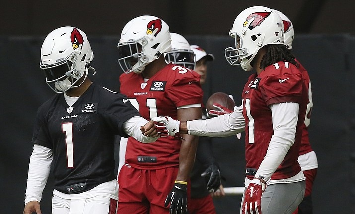 Arizona Cardinals quarterback Kyler Murray (1) gets a fist bump from Cardinals wide receiver Larry Fitzgerald, right, after the two connected on a pass completion during NFL football practice at State Farm Stadium Friday, July 26, 2019, in Glendale, Ariz. (Ross D. Franklin/AP)