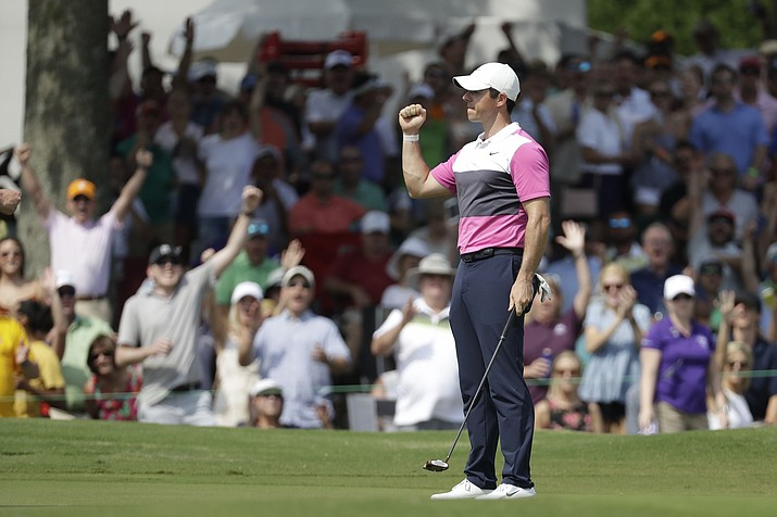 Rory McIlroy, of Northern Ireland, celebrates after sinking his birdie putt on the 18th green to give him the lead during the third round of the World Golf Championships-FedEx St. Jude Invitational Saturday, July 27, 2019, in Memphis, Tenn. McIlroy finished the day at 12-under par, one stroke ahead of Brooks Kopeka. (Mark Humphrey/AP)