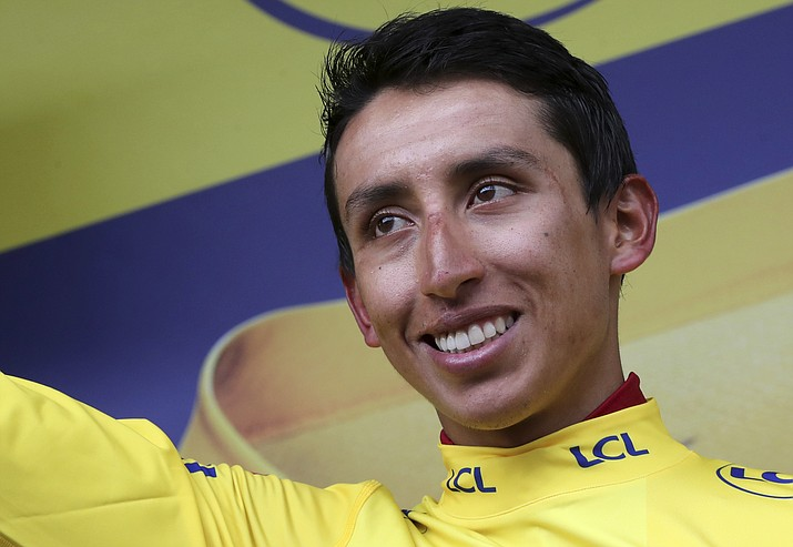 Colombia's Egan Bernal wearing the overall leader's yellow jersey celebrates on the podium after the 20th stage of the Tour de France over 59,5 kilometers (36,97 miles) with start in Albertville and finish in Val Thorens, France, Saturday, July 27, 2019. (Thibault Camus/AP)