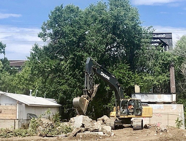 Heavy equipment has been on site at the Hilton Garden Inn location at the corner of Montezuma and Sheldon streets in downtown Prescott for several weeks. City officials say the needed underground infrastructure work is now complete, and the aboveground improvements are expected to begin soon. (Cindy Barks/Courier)