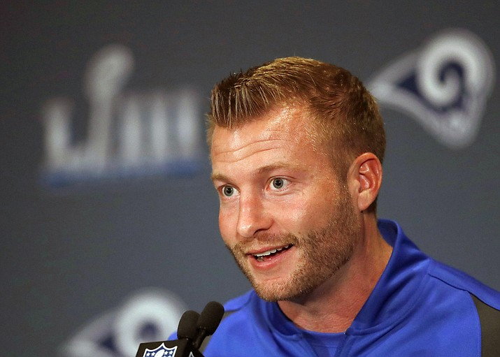 In this Jan. 30, 2019, file photo, Los Angeles Rams head coach Sean McVay speaks during a news conference ahead of the NFL Super Bowl 53 football game against the New England Patriots, in Atlanta. Coach Sean McVay and general manager Les Snead have agreed to contract extensions through 2023 with the Los Angeles Rams. The defending NFC champions announced the deal Friday, July 26, 2019, while veterans reported to training camp in Orange County. (John Bazemore/AP, file)