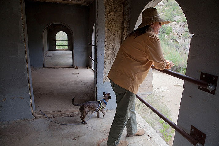 Andrew Ambos and his dog, Dog, at Gold King Mansion in the Hualapai Mountains. (Photo by Michelle Drumheller/Courtesy)