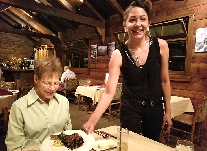 Eloise Baldauf being served her entree of pork chop in kumquat glaze. Photo courtesy of The Dunnery