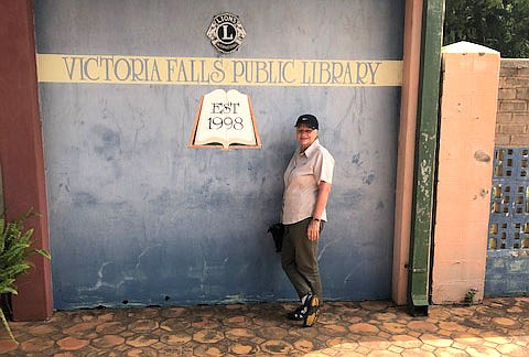 Cheryl Yeatts pictured at the entrance of Victoria Falls Public Library, Zimbabwe. This library was established in 1998.