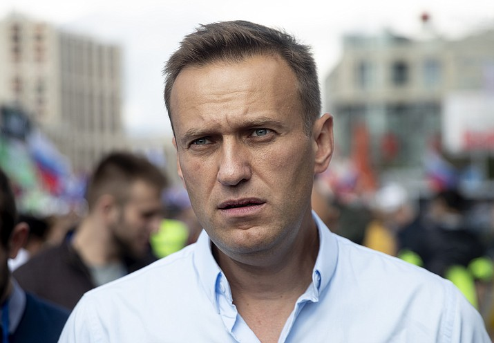 In this July 20, 2019, file photo, Russian opposition leader Alexei Navalny attends a protest in Moscow, Russia. Navalny remained hospitalized for a second day on Monday, July 29, 2019, after his physician said he may have been poisoned. Details about Navalny's condition were scarce after Navalny was rushed to a hospital Sunday from a detention facility where he was serving a 30-day sentence for calling an unsanctioned protest. (AP Photo/Pavel Golovkin, File)