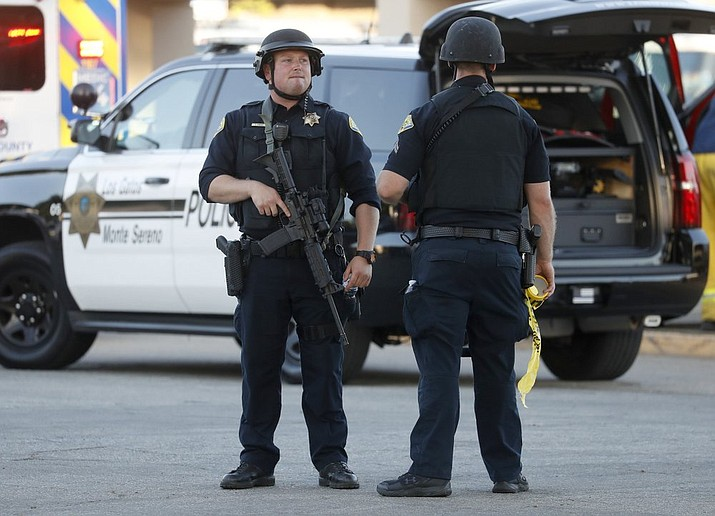 Police stand guard outside Gilroy High School following a deadly shooting at the Gilroy Garlic Festival in Gilroy, California, on Sunday, July 28, 2019. (Nhat V. Meyer/San Jose Mercury News)