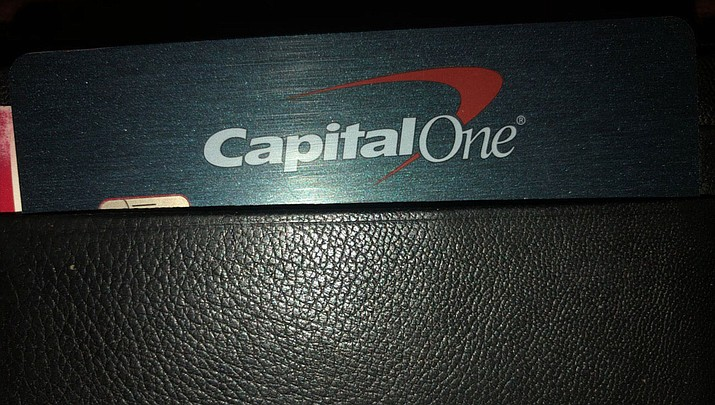 A Capital One credit card is shown in a wallet in Kingman. A security breach at Capital One Financial, one of the nation's largest issuers of credit cards, compromised the personal information of about 106 million people, and in some cases the hacker obtained Social Security and bank account numbers. (Photo by Shawn Byrne/Daily Miner)