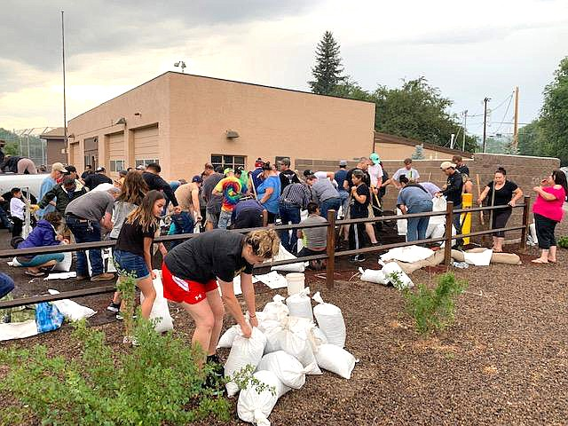 Residents of the Sunnyside neighborhood fill sandbags to prepare for possible flash flooding in the Museum Fire's nearly 2,000-acre burn area in late July. (Photo by Laurel Morales/KJZZ)