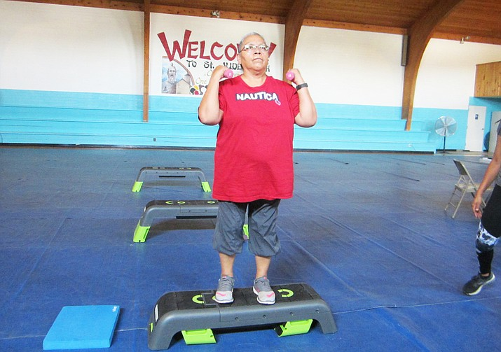 Dottie Sumatzkuku learns about balance and strengthing exerices at St. Jude's Catholic Church gym in Tuba City. Sumatzkuku is a breast cancer survivor and is part of Restoring Balance, a study looking at the effects of exercise on Native American cancer survivors. (Katherine Locke/NHO)