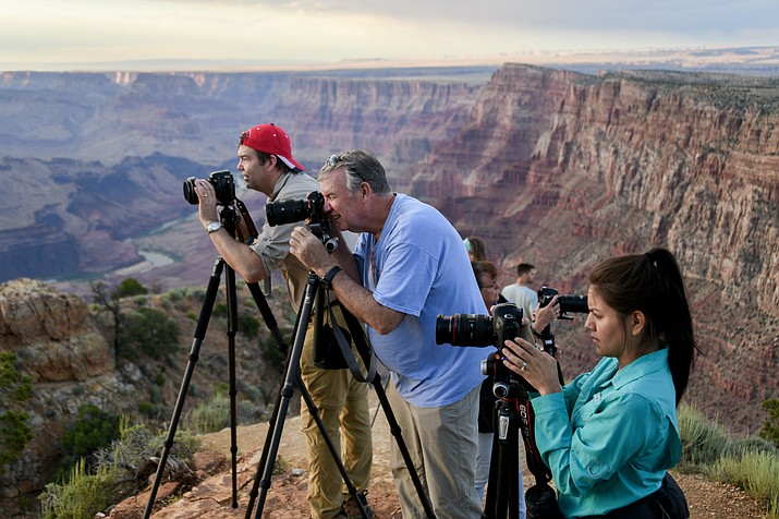 Students with a Grand Canyon Conservancy Field Institute photography class wait for a summer monsson storms on the South Rim of Grand Canyon National Park. (Terri Attridge/WGCN)
