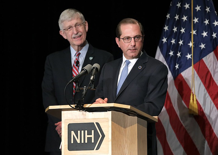 Alex Azar, right, the secretary of the U.S. Department of Health and Human Services, speaks during a conference.  Azar has announced that the U.S. is setting up a plan to allow residents to purchase prescription meds from Canada. (DHHS photo)