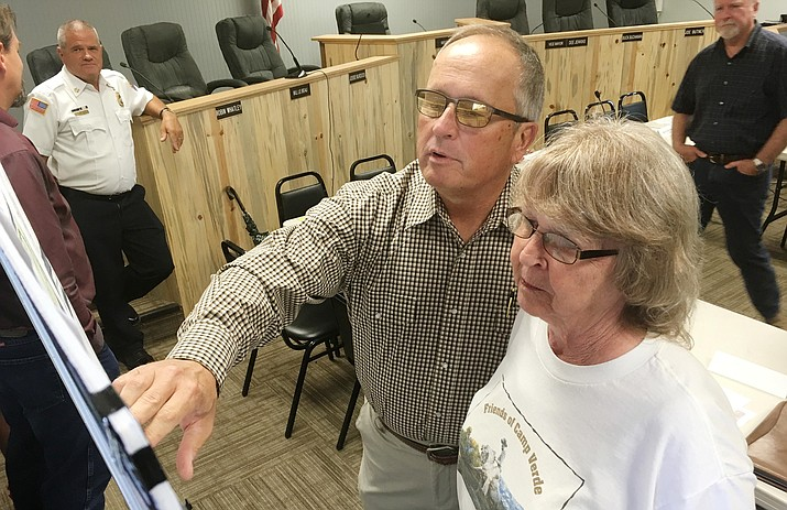 Camp Verde Town Council Member Bill LeBeau and Camp Verde resident Charlotte Salsman look at the proposed Verde Connect project before council's work session Wednesday with the project's partnering agencies. VVN/Bill Helm