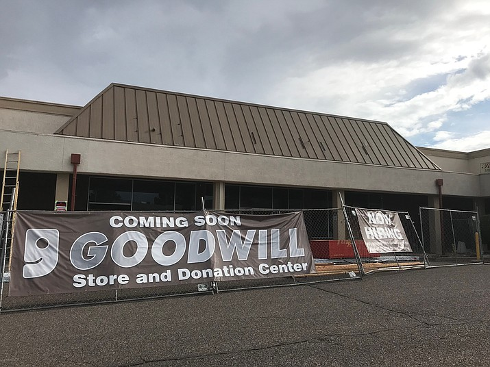 A banner attached to touts the new location of Cottonwood's Goodwill thrift store, and encourages applying for employment via the website. The store will be moving from its location of many years, on Mingus Avenue, to this spot in the Food City shopping center sometime this fall. VVN / Jason W. Brooks