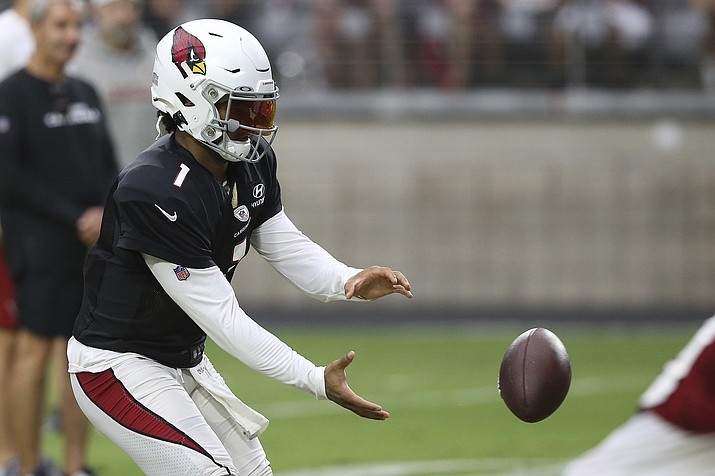 Arizona Cardinals quarterback Kyler Murray takes a snap of a football during training camp Wednesday, July 31, 2019, in Glendale, Ariz. (Ross D. Franklin/AP)