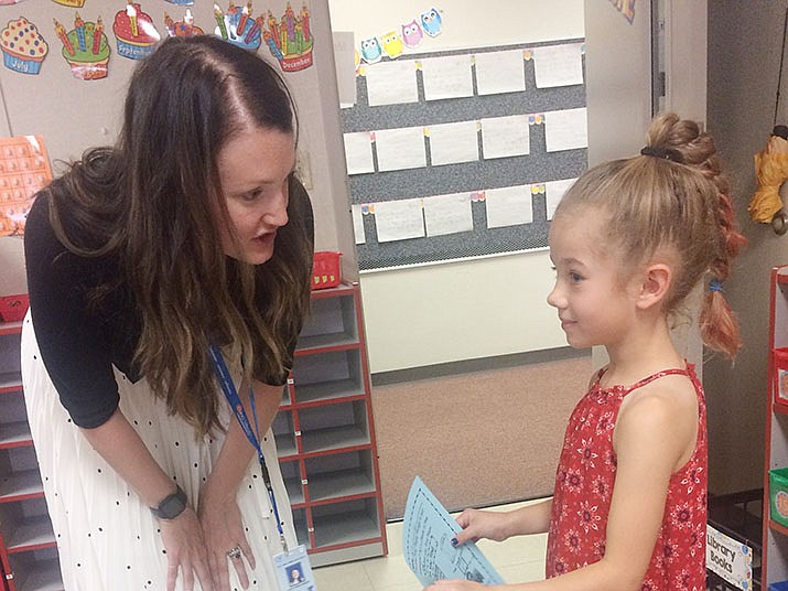 Lizzy Kreitinger, first grade teacher at Territorial Early Childhood Center, meets Hayden Gray, a student in her class, during the Meet the Teacher event Thursday, Aug. 1. Meet the Teacher allows students to see their teacher and classrooms before the first day of school. (Jason Wheeler/Review)