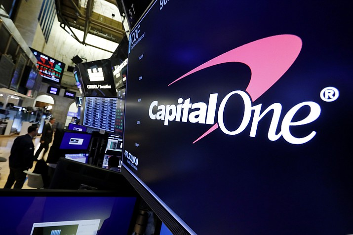 In this Tuesday, July 30, 2019, file photo, the logo for Capital One Financial appears above a trading post on the floor of the New York Stock Exchange. Data breaches through hacking attacks are common these days, and personal details about you can lead to identity theft, such as credit cards and loans in your name. Yet few victims can ever pin the blame on any specific breach, whether that's Equifax from 2017 or the recently disclosed breach at Capital One. (AP Photo/Richard Drew, File)