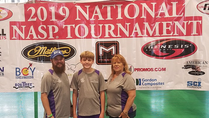 Bryce Henak, center, poses with Emmanuel Christian Academy coaches Tom Rowan and Dottie Bollinger (Courtesy)