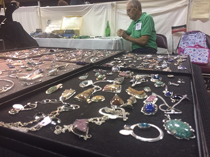 Michael Harris of M. H. Fine Jewelry Design works on a piece at the Prescott Gem & Mineral Club's 16th annual Prescott Gem & Mineral Show at the Findlay Toyota Center. The show continues at 9 a.m. Sunday, Aug. 4. (Jason Wheeler/Courier)